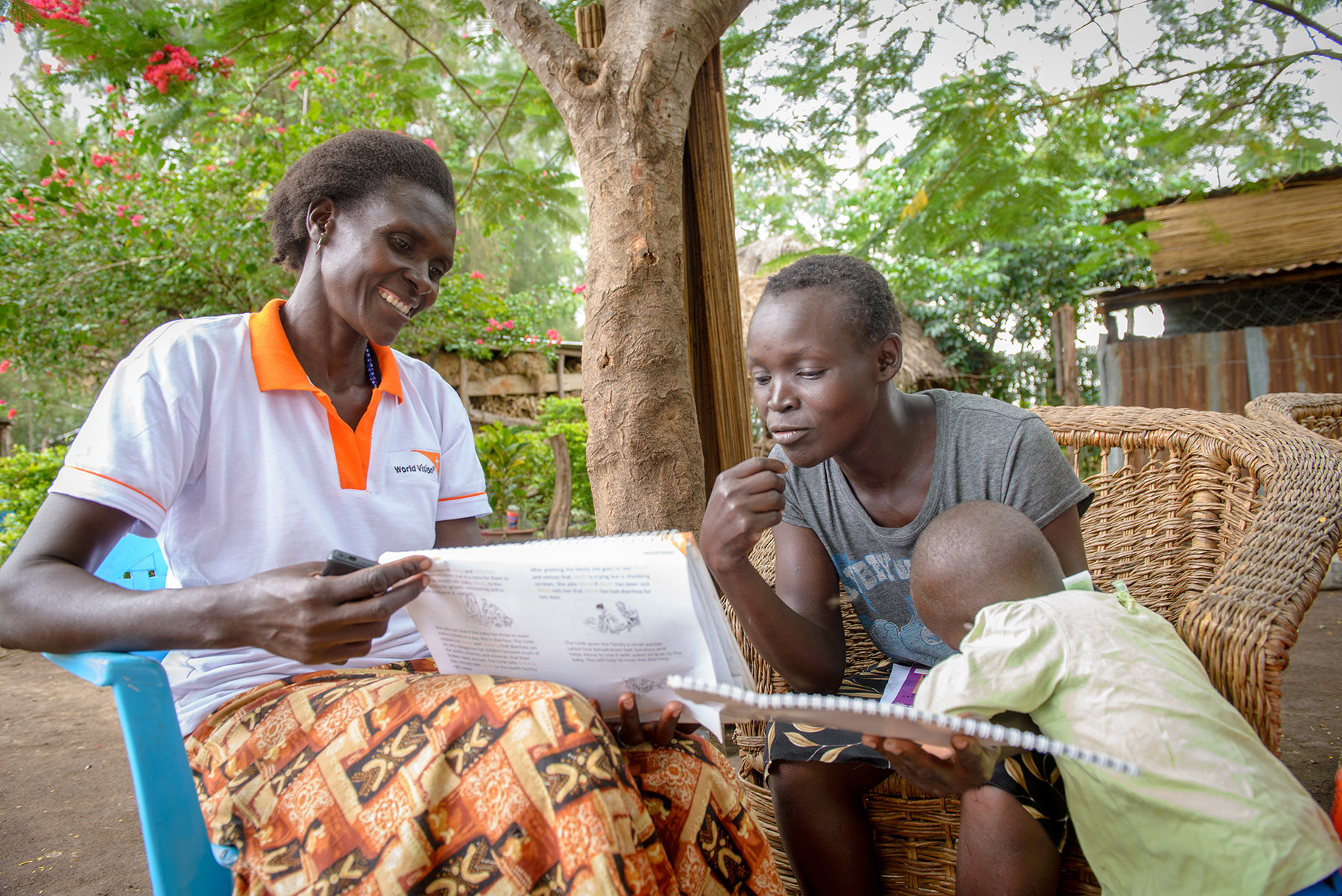 A World Vision Community Health Worker meets with a family in Africa