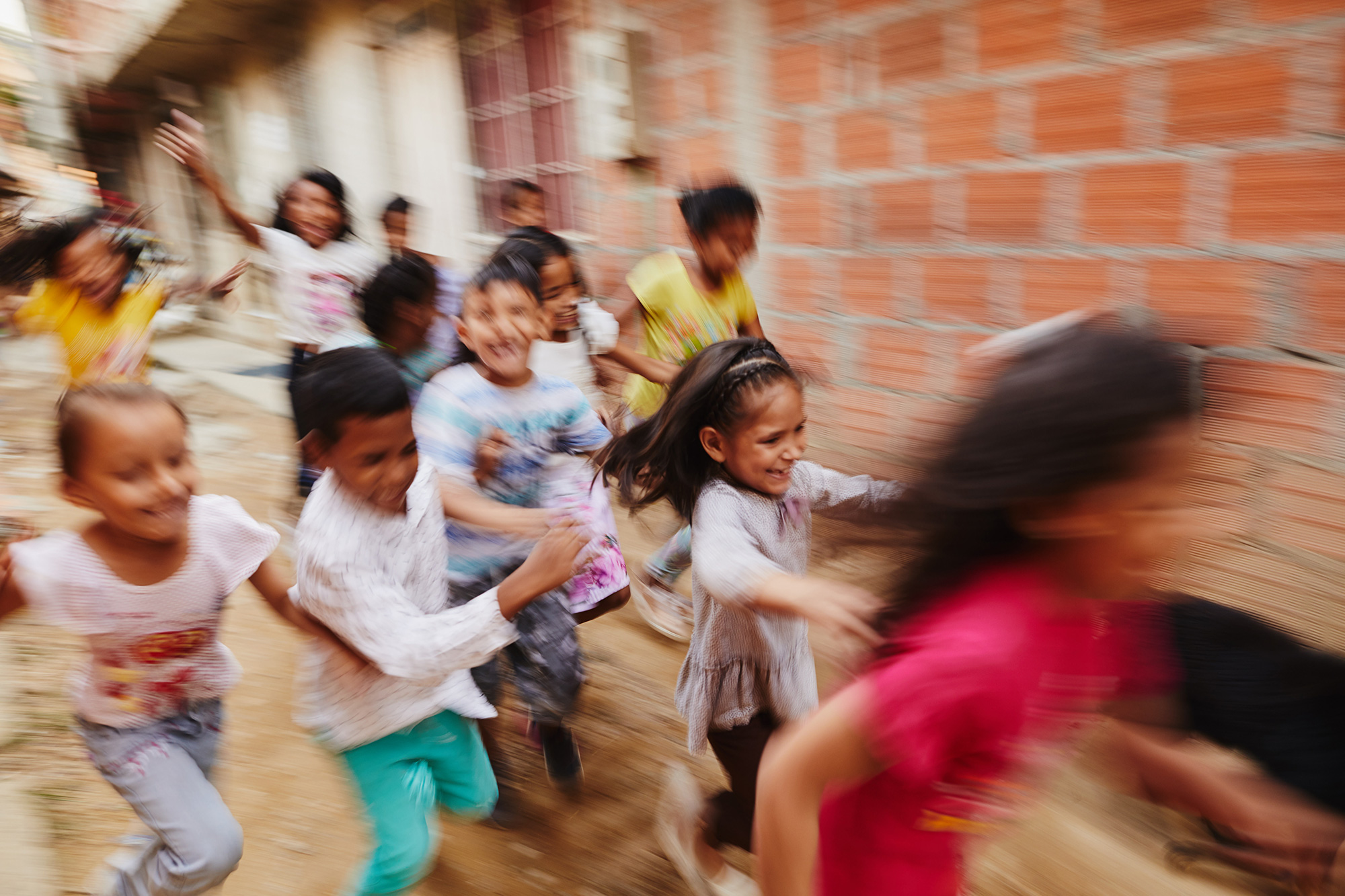 A group of children run in Colombia