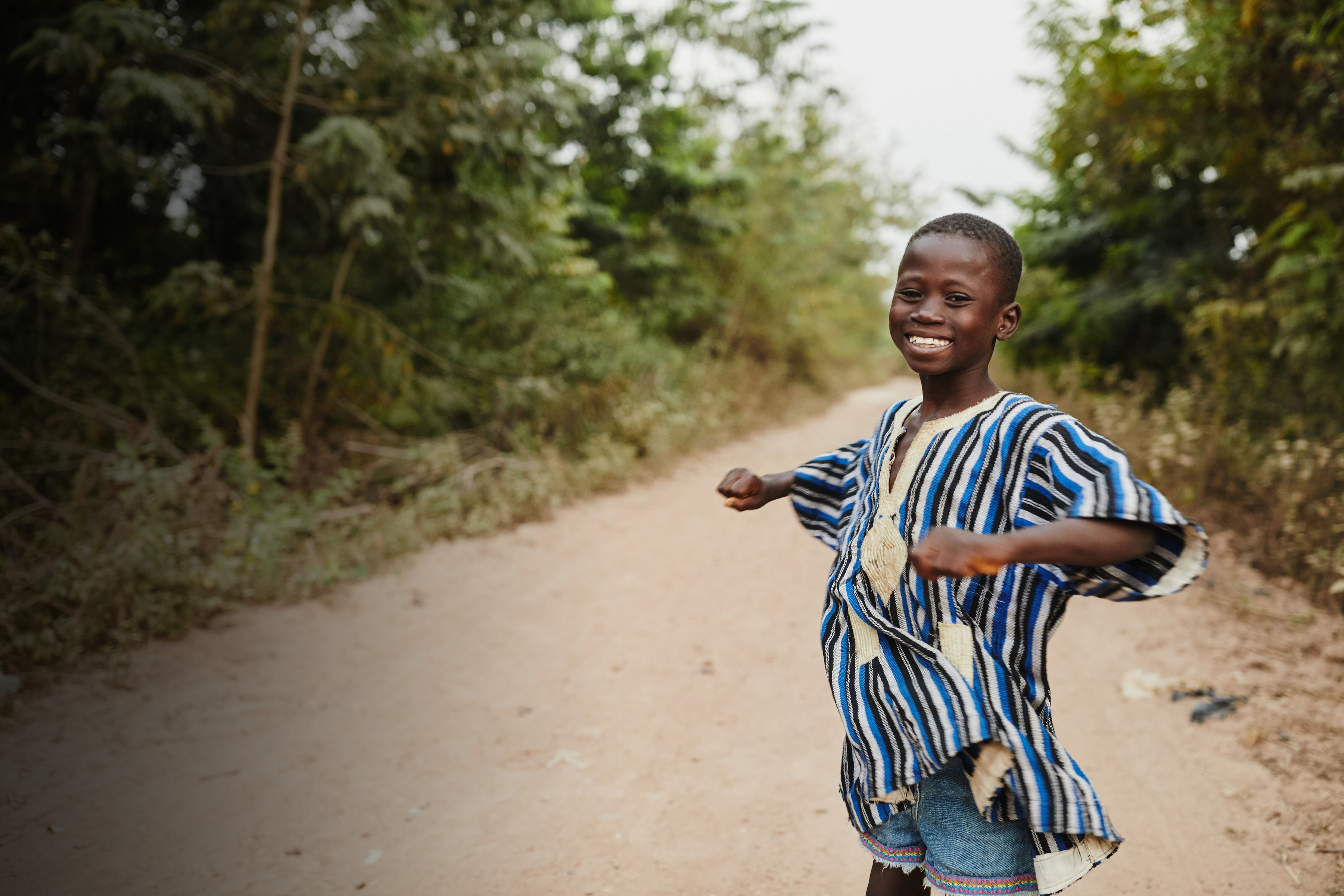 A Boy in Ghana on a road