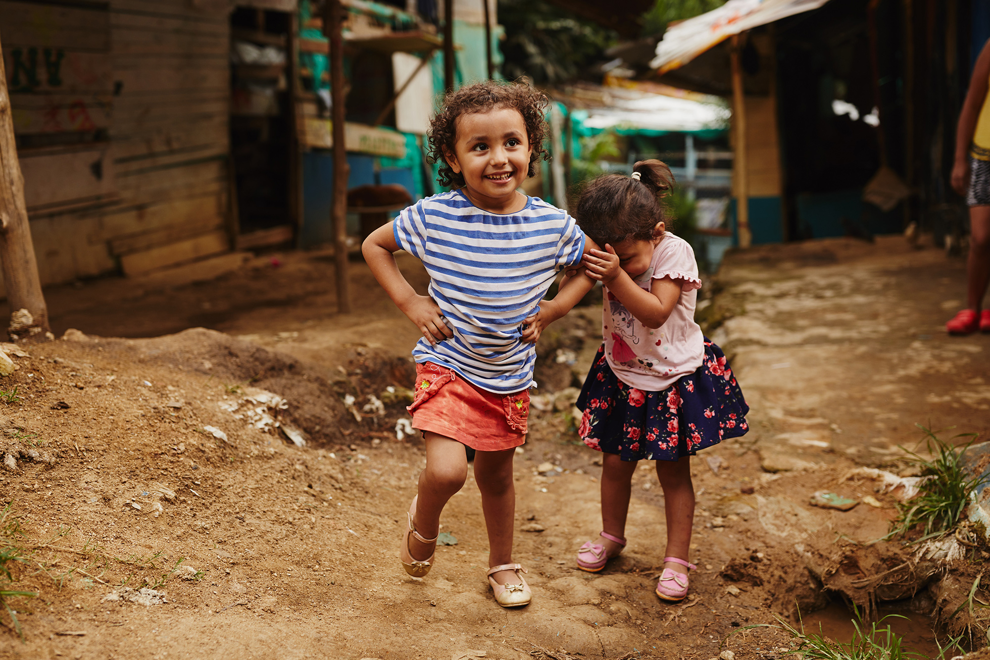 A girl and her sister play in rural Colombia