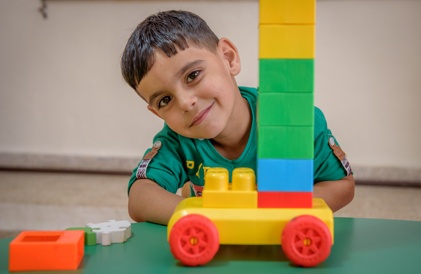 Boy playing with blocks and car