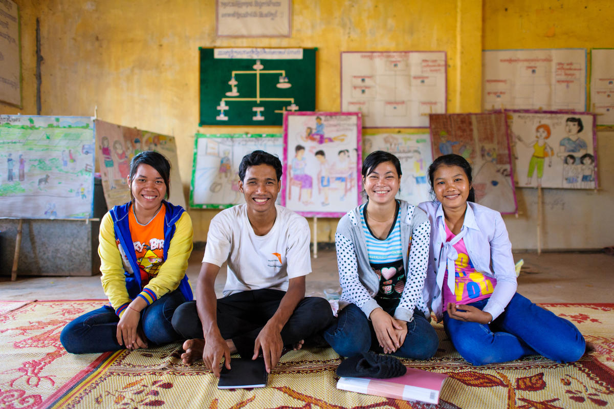 Khmer youth sit on the floor of their community space, Cambodia