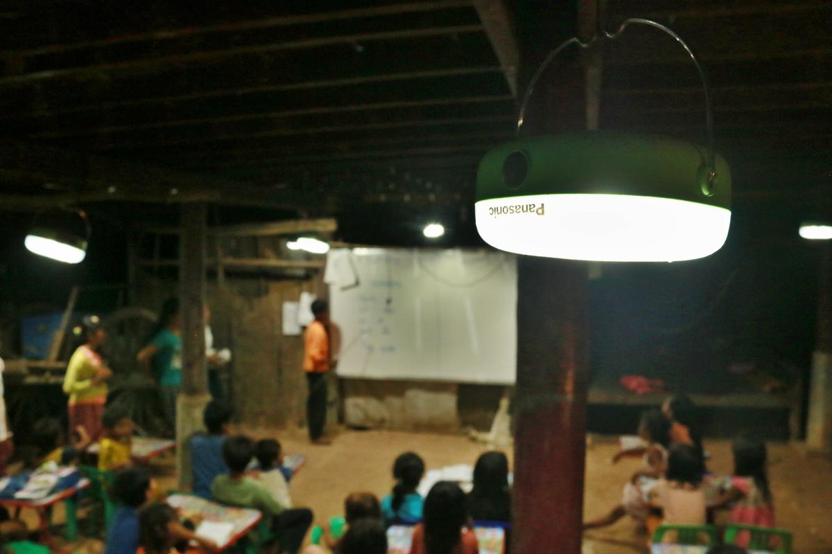 Panasonic lantern provides light for students to do their homework, Cambodia