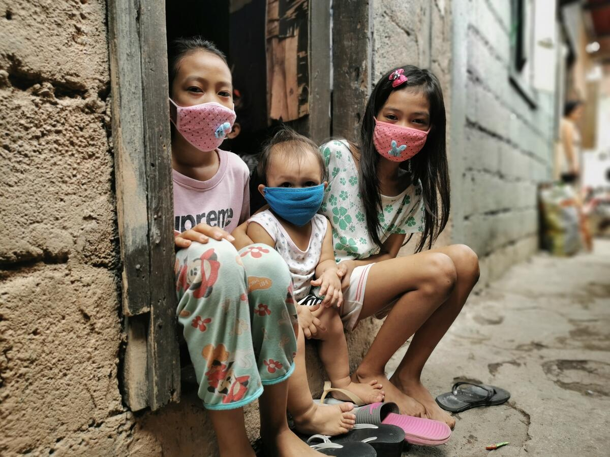 Three children in masks isolated at home