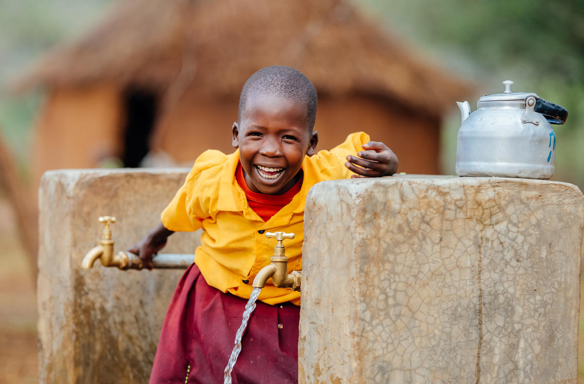 Cheru with clean water in Kenya