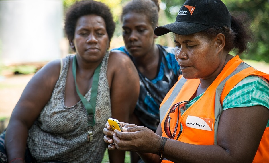 Frontline health workers using mobile phones