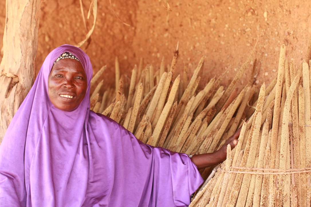 Tshara Yahaya (48) member of the village saving group showing her millet stock from this year harvest