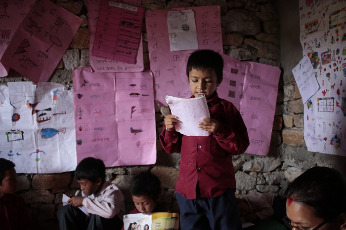 A child reads aloud at a literacy reading camp in Nepal