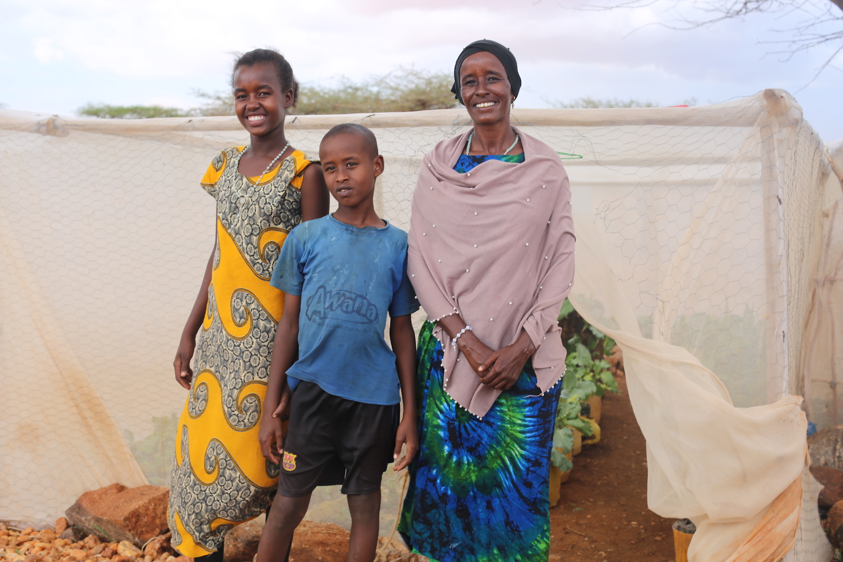 Right to Left; Saroi with her two children Lolusu (8) and Neitumu (10). © Copyright World Vision/By Irene Sinoya.