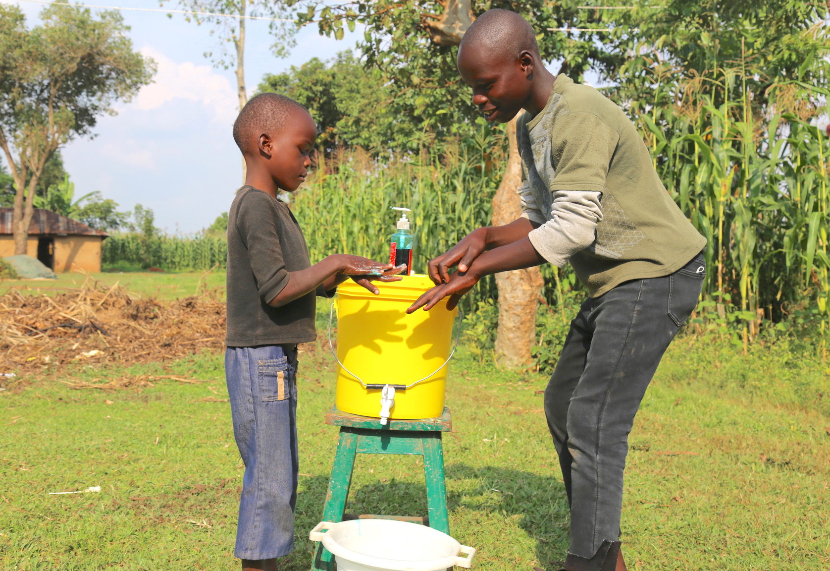 Raphael (right) teaches his brother how to effectively wash hands with soap to prevent COVID-19 and other disease. ©World Vision Photo/Irene Sinoya.