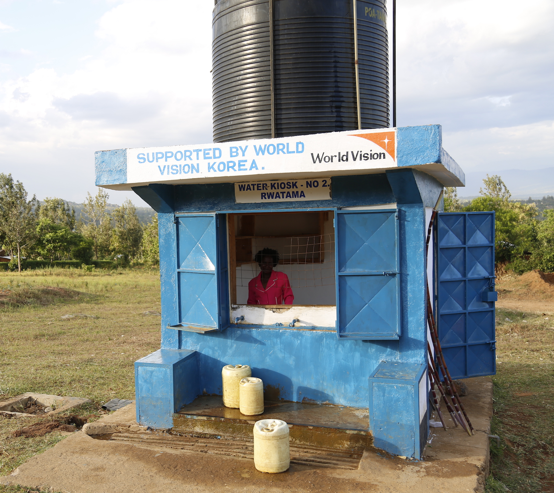 Mary at the water kiosk built by World Vision in Angurai, Western Kenya. © World Vision/Photo by Susan Otieno