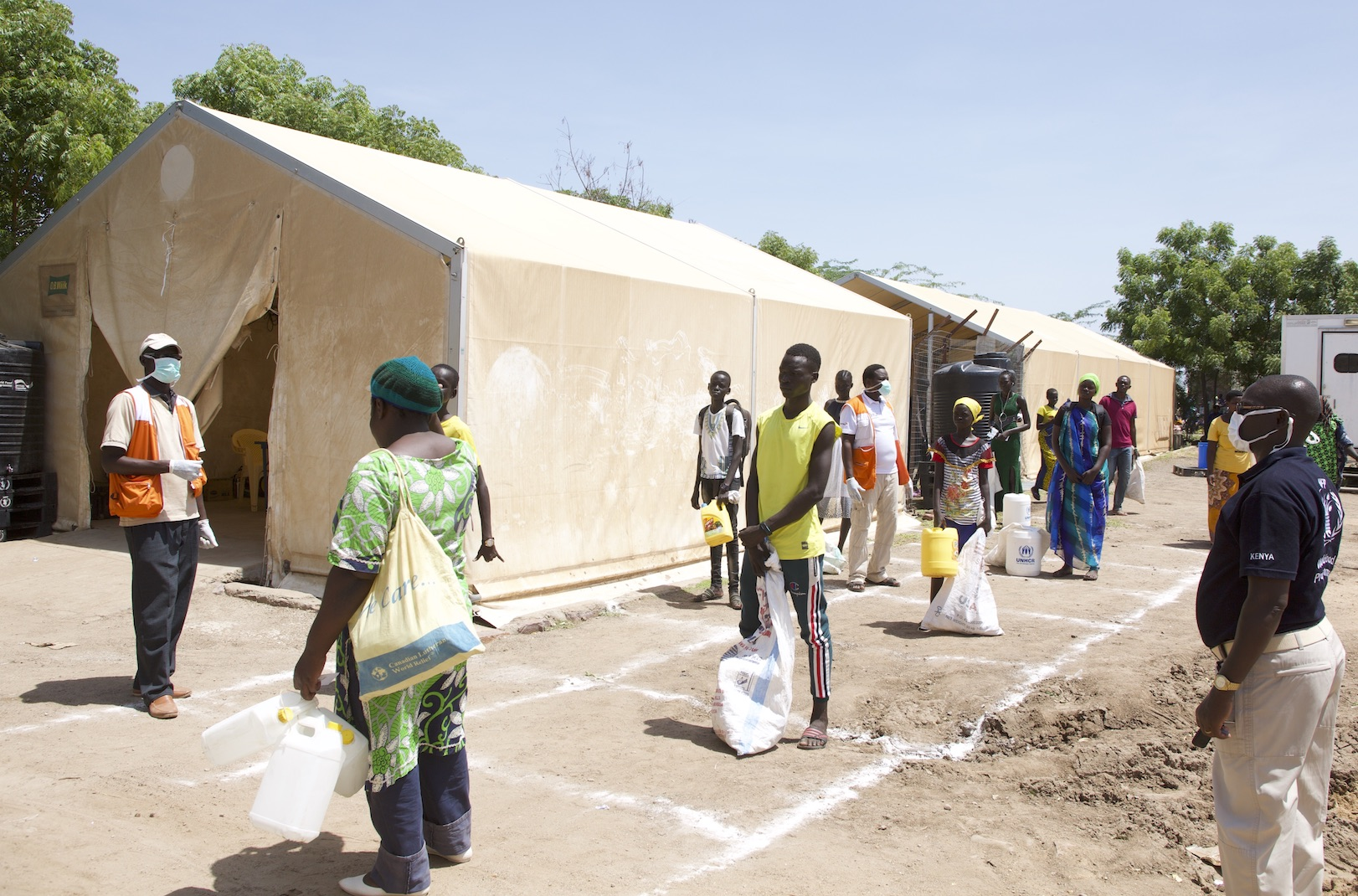 People maintaining social distancing at Kakuma Refugee Camp to stop the spread of COVID-19. ©World Vision Photo