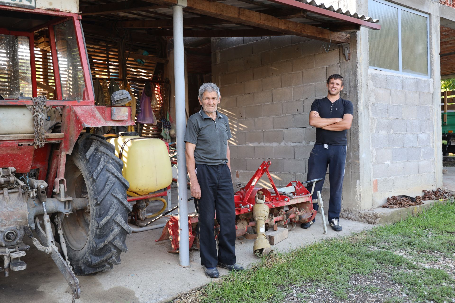 Ratko and his grandson Radislav stand by the donated tools