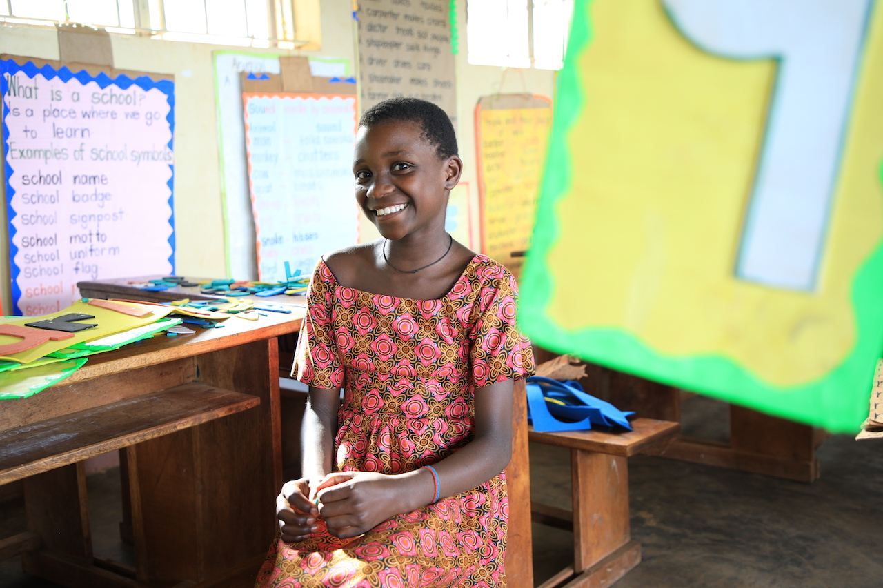 Maria in her print-rich classroom World Vision Uganda Education Improving classroom enviroment