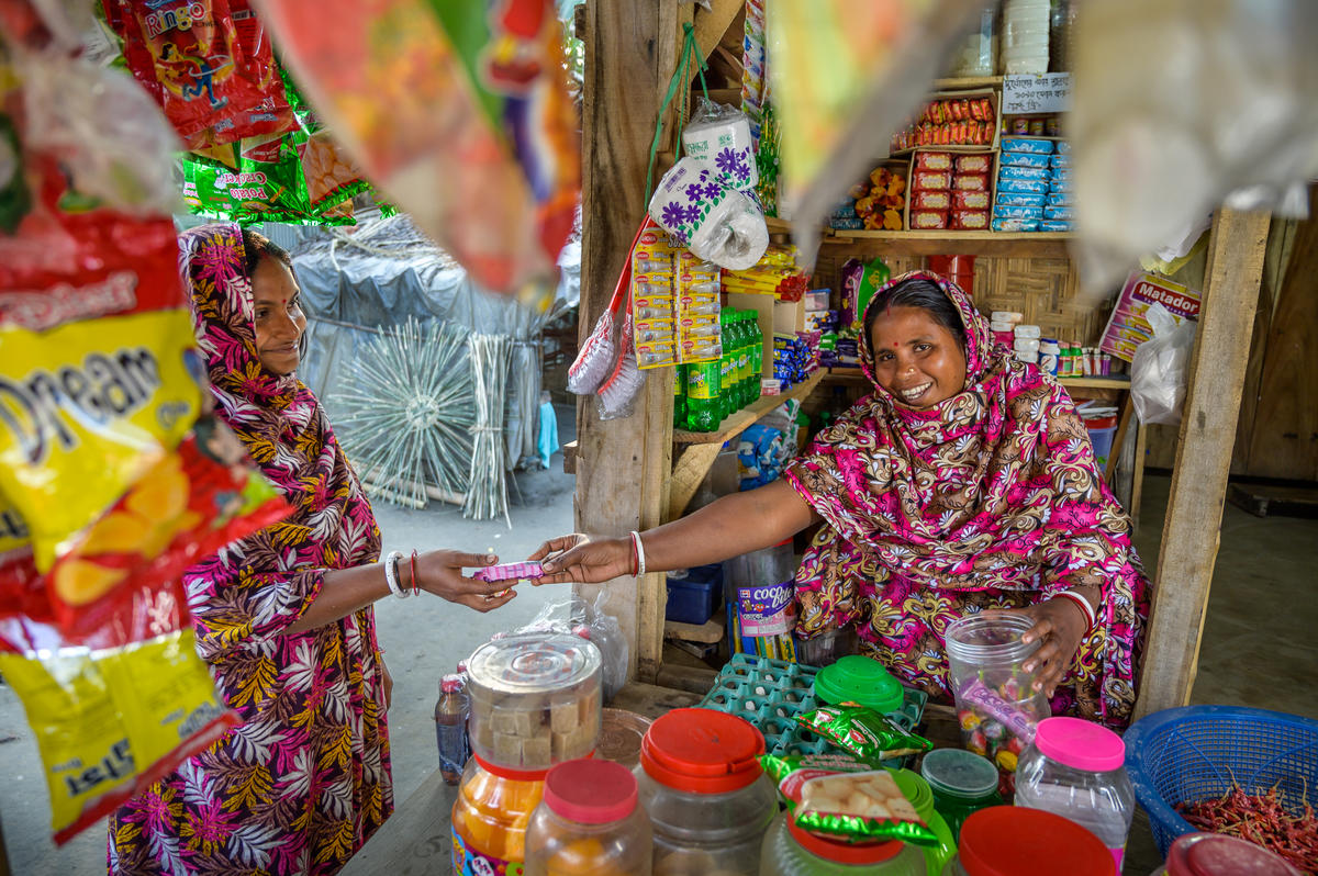 Shabitri makes a sale in her grocery shop