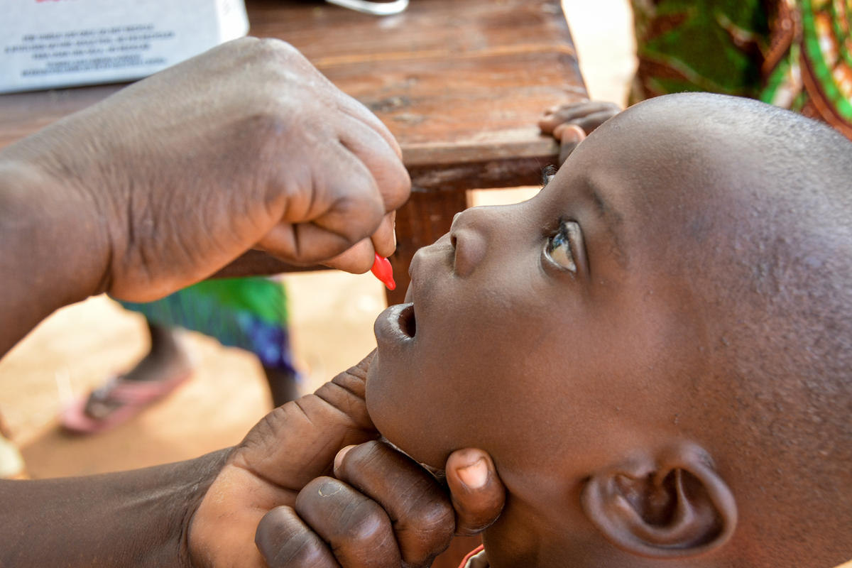 Child gets an oral vaccination