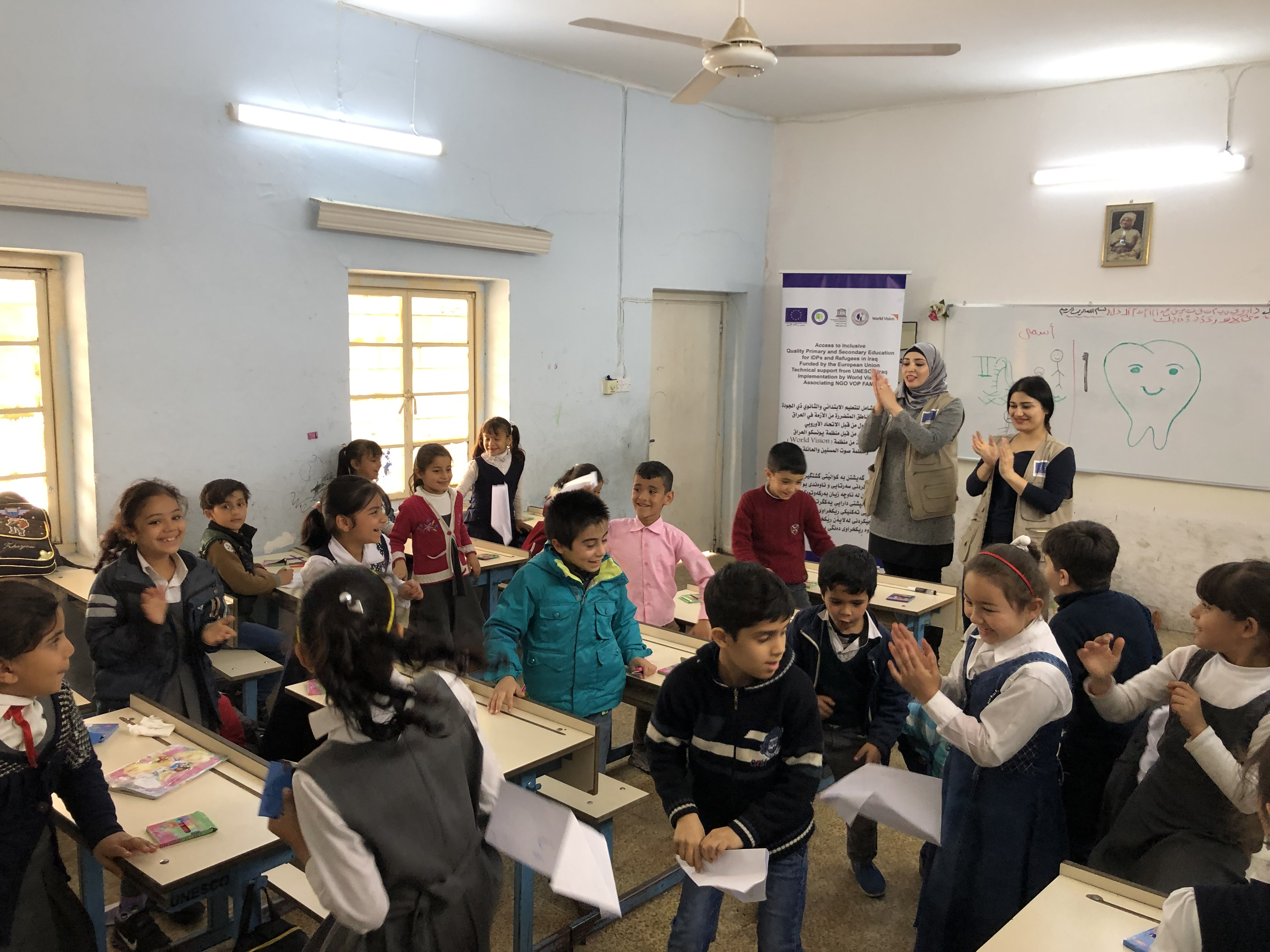 Children flying their paper planes to get rid of negative feelings as part of the psychosocial support session at Al-Elm Al-Nafe'e Primary Coed School for IDPs in Erbil, Iraq