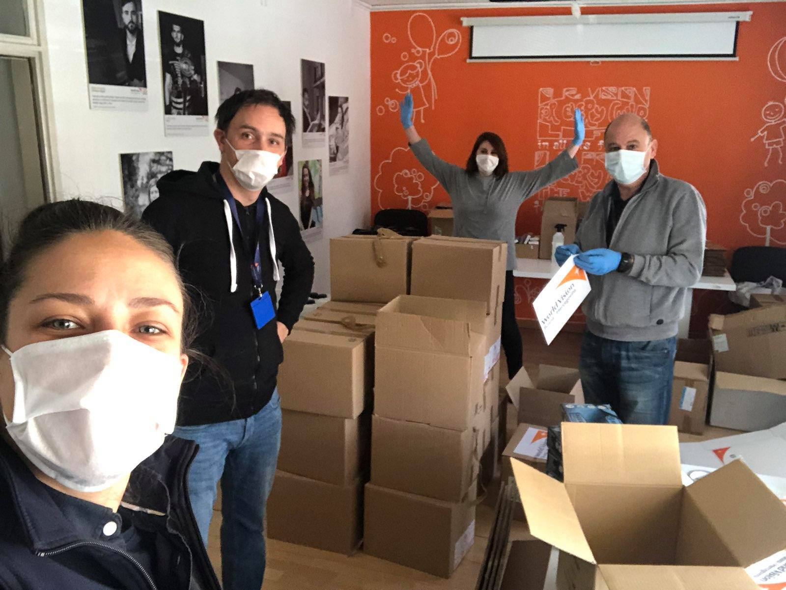 Darko Arsenovski, World Vision BiH Security Officer in the centre, team selfie while packing H&H items