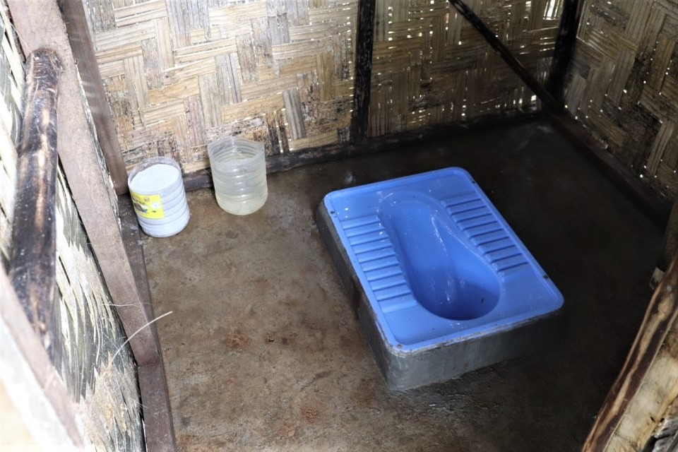 Inside one of the toilets in plastic compound. The community through self-reliance contributed funds towards purchase of Portland cement used for the concrete slabs and other hardware materials.
