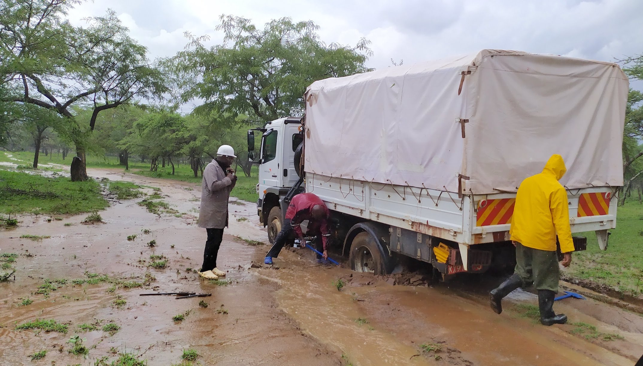 Heavy rainfall causes one of the trucks of the Kenya drilling to get stuck along the way.