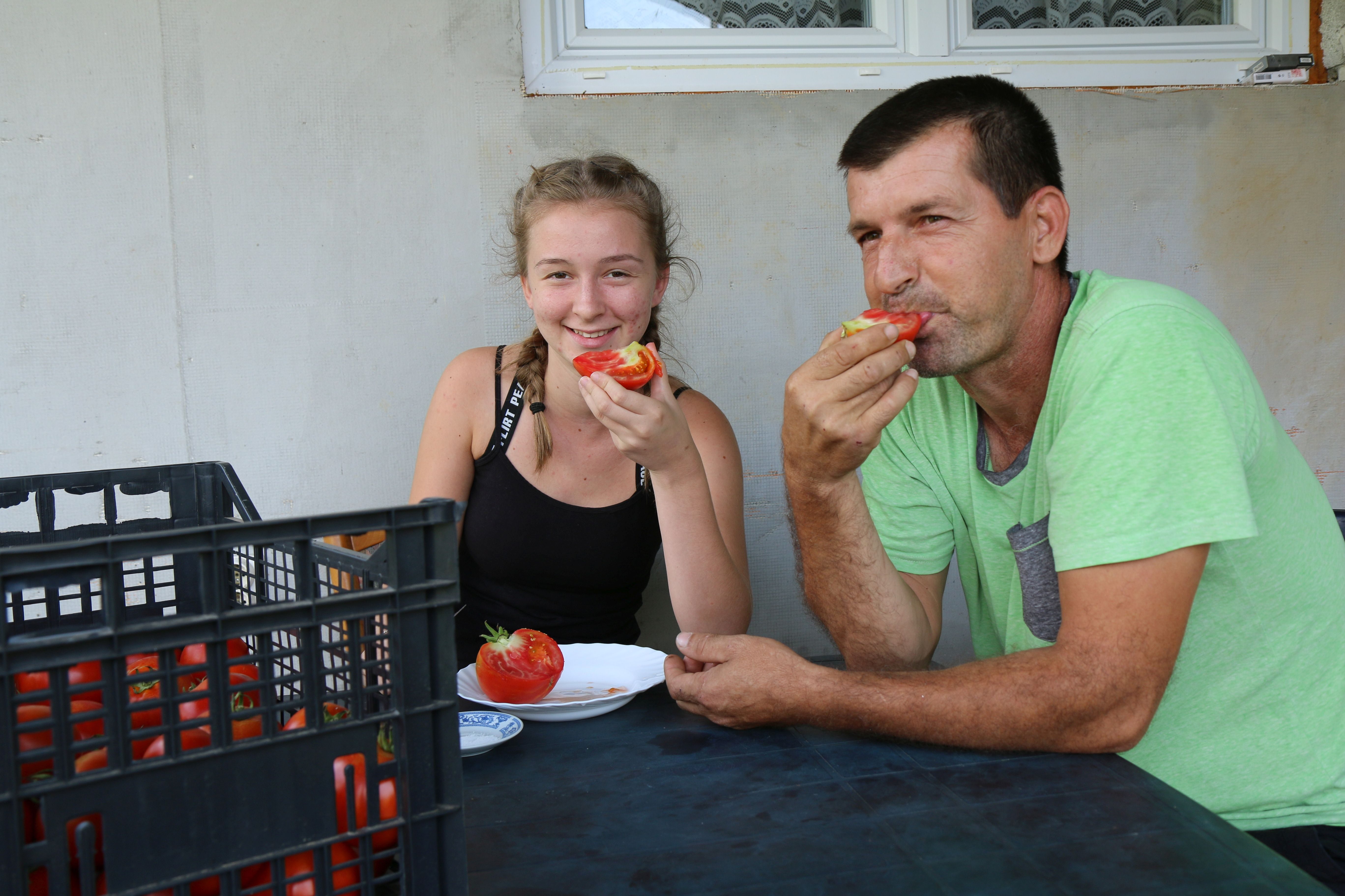 Šaban, landmine accident survivor, and his oldest daughter taste the fruits of their labor.