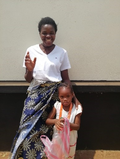 Annie, a volunteer and Abigail, waiting for sponsorship