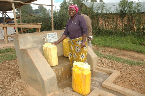 ​​Marie Grace happily fetching water from one of World Vision's established water points