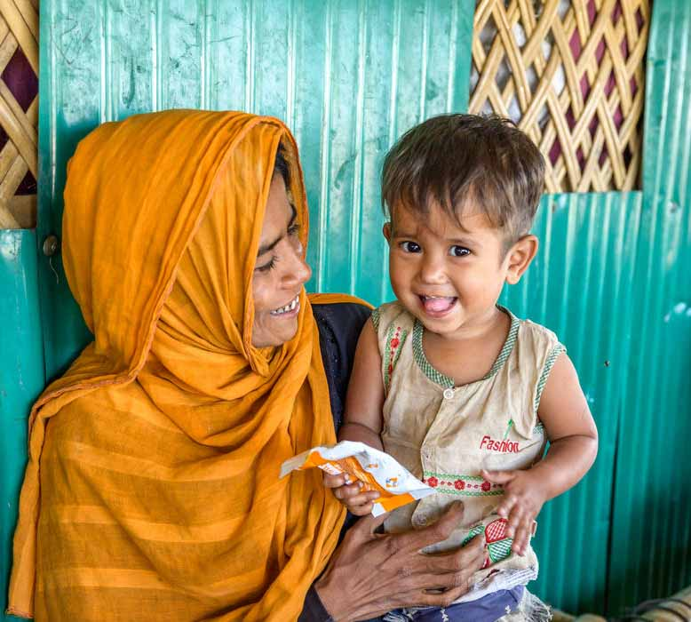 MALNUTRITION PREVENTION: Jaheda celebrates 2-year-old Minara's recovery from  moderate acute malnutrition after she received treatment at World Vision's feeding centre.