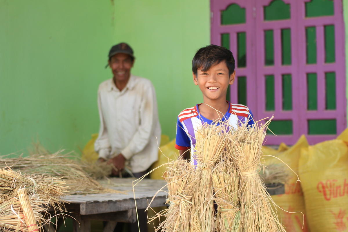 Chamrong and his father at their home in Cambodia.