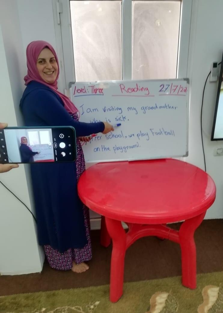 Nashed teaches english via cell phone in Jordan to Syrian refugee children