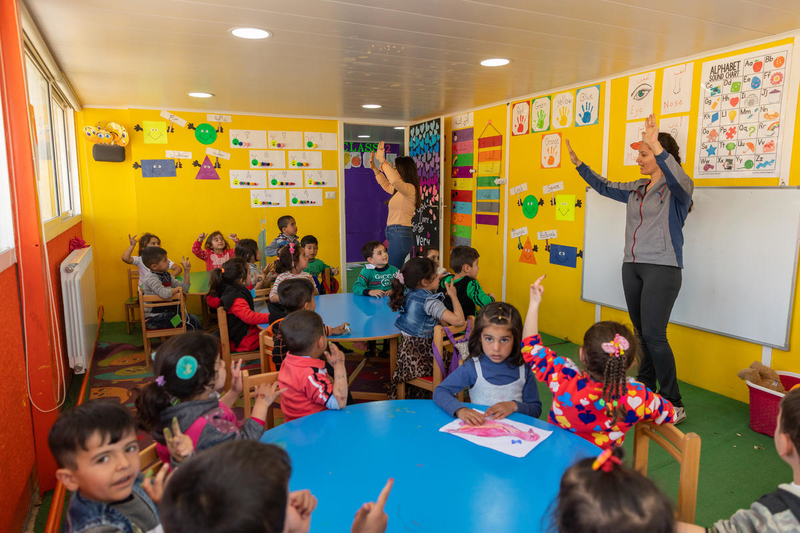 Children learn letters and numbers in an early childhood education programme in Bekaa Valley, Lebanon.