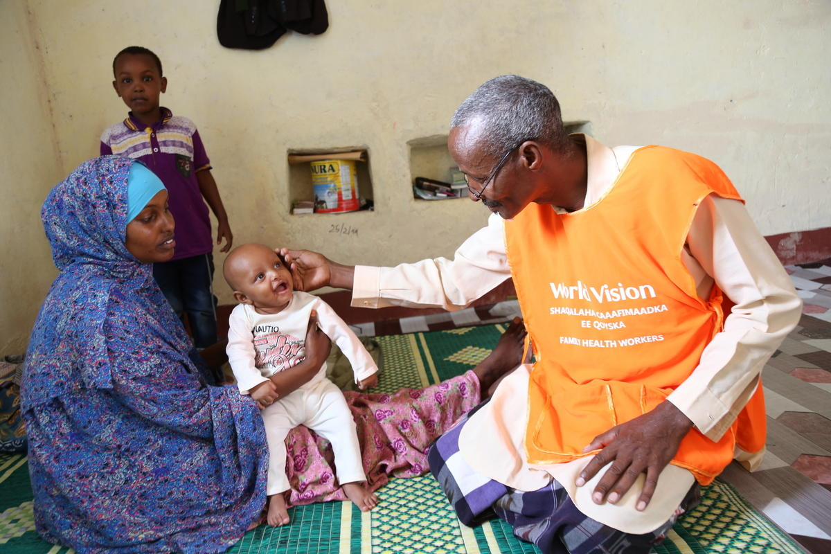 Dayib Visits Kowsar Hussein and her 2-months-old child at home. Dayib had referred Kowsar to Borama Hospital where she delivered her child. July 13, 2019
