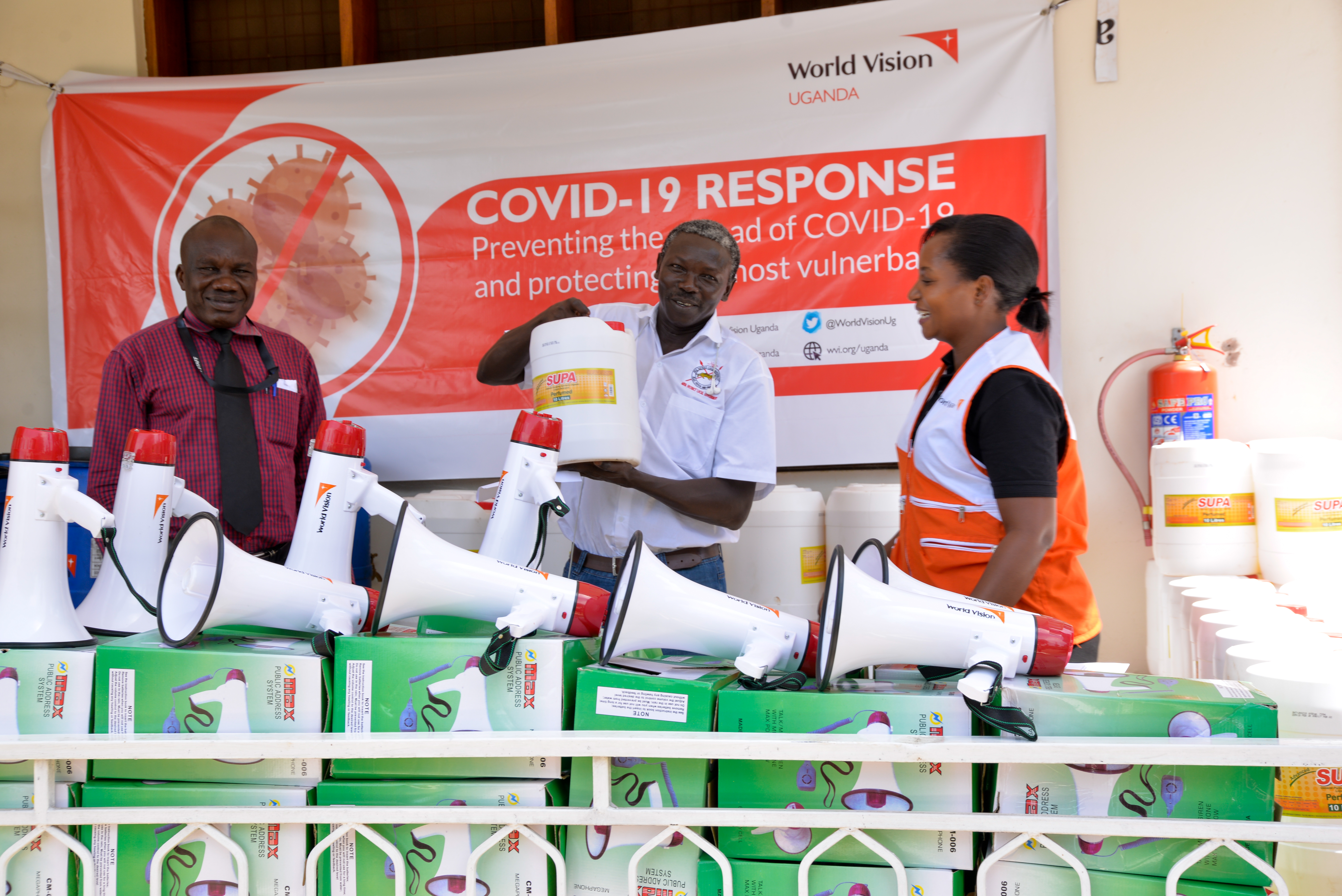 World Vision handing over 2,560 litres of liquid soap and other items to the Arua District Health Officer