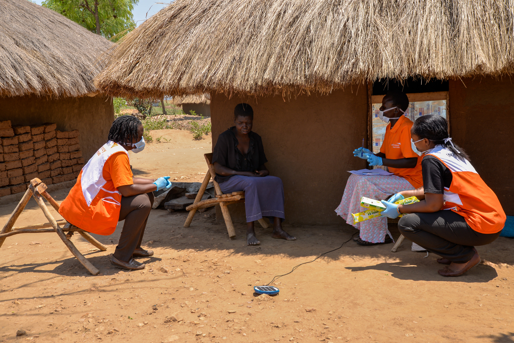 World Vision staff visiting a household in Omugo settlement during soap distribution