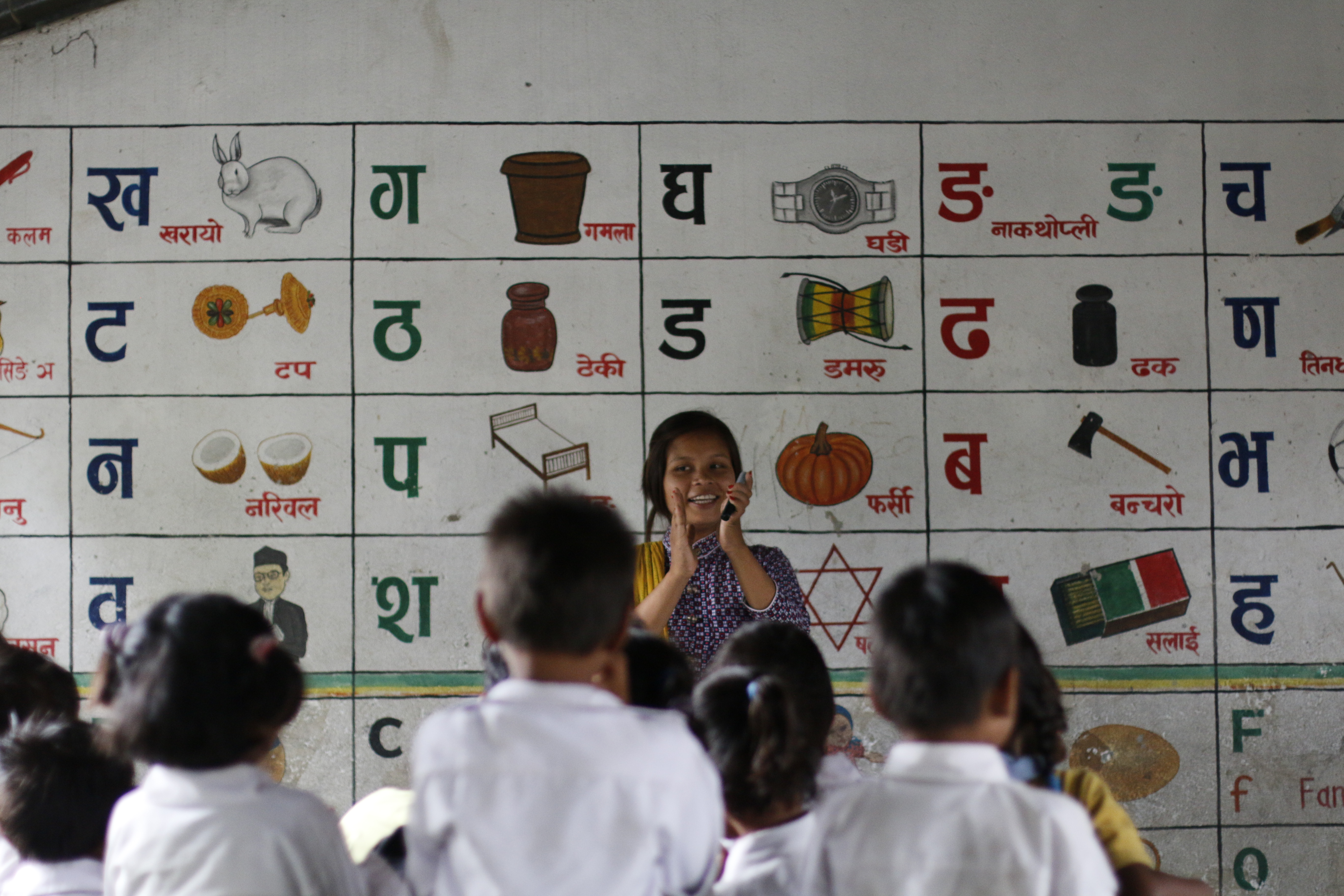 Prabha engages primary level students in a rhymes