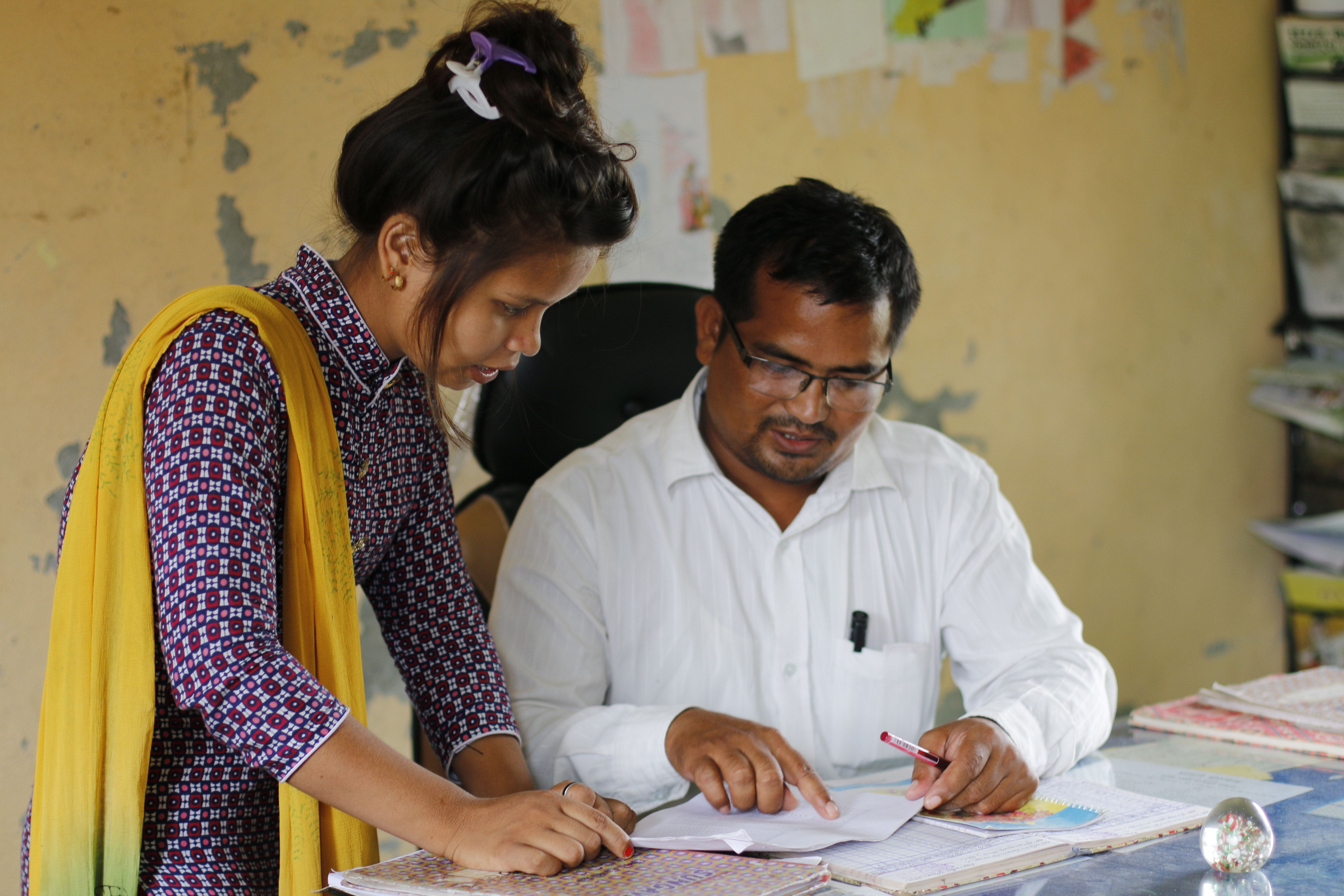Prabha works along with a teacher of the school