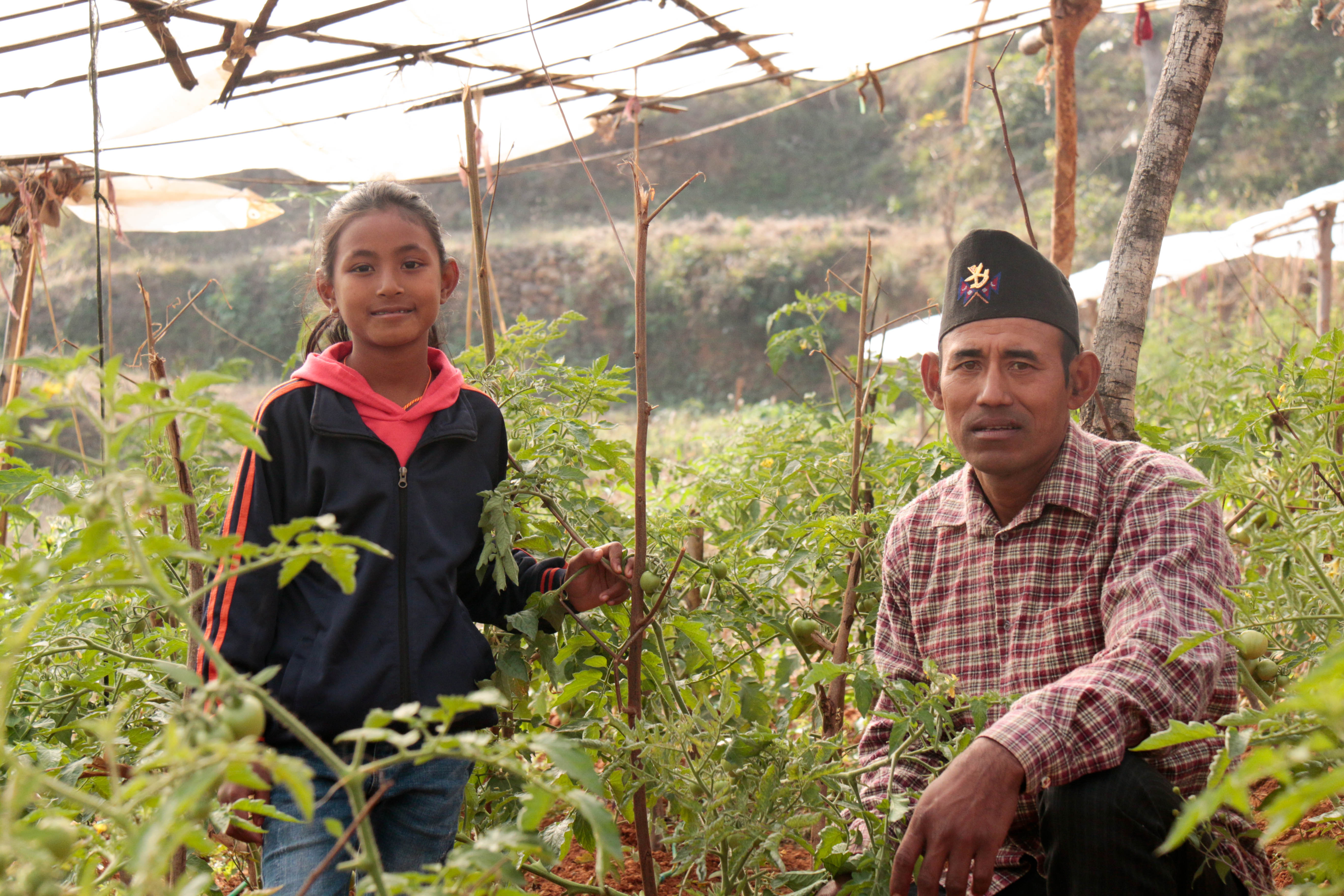Hisila and her father in their farm