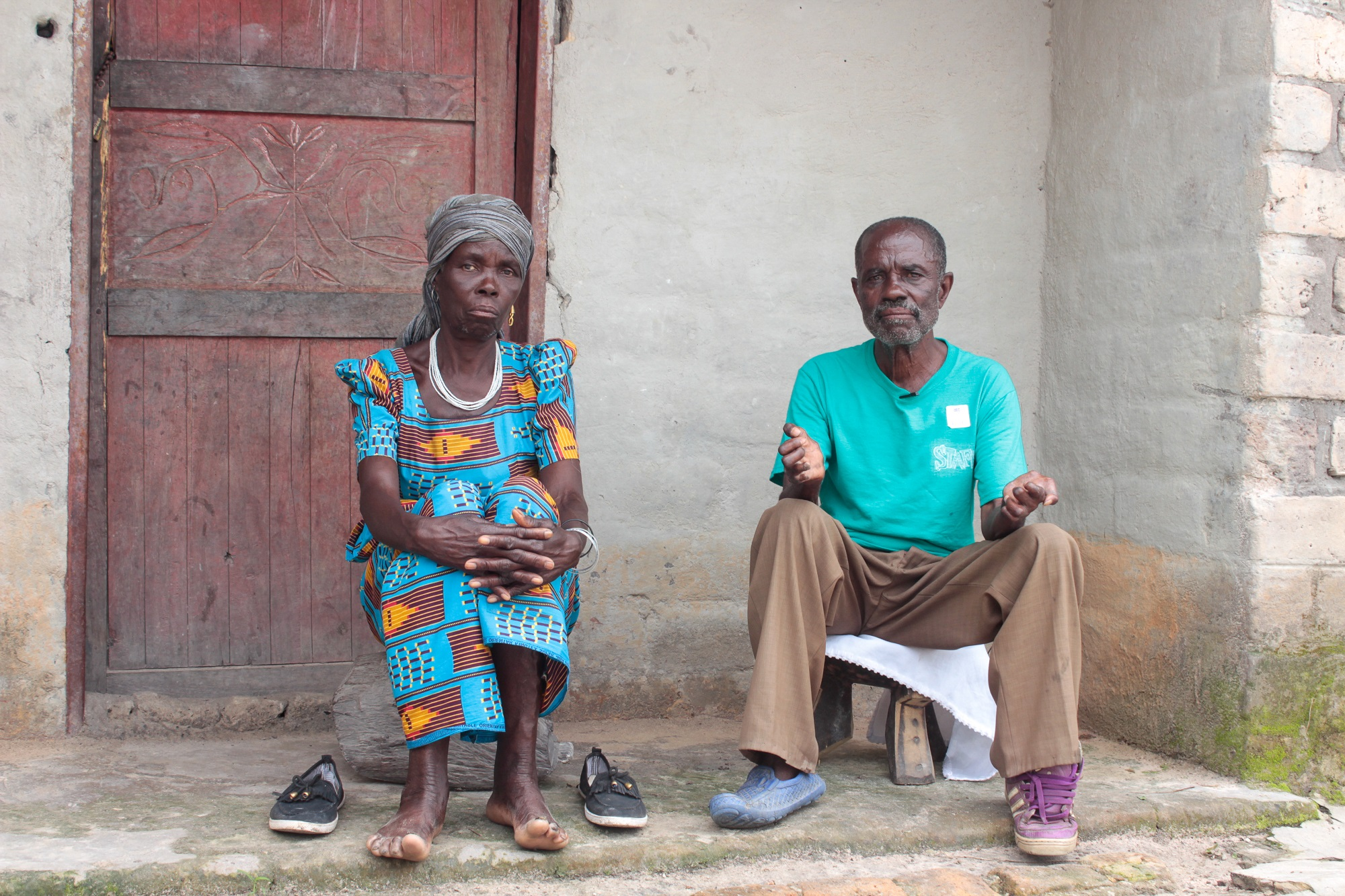 Stephen Kampapa village headman and his wife Apwina kampapa. sitting outside their home they were among the first people to be relocated here in 1988