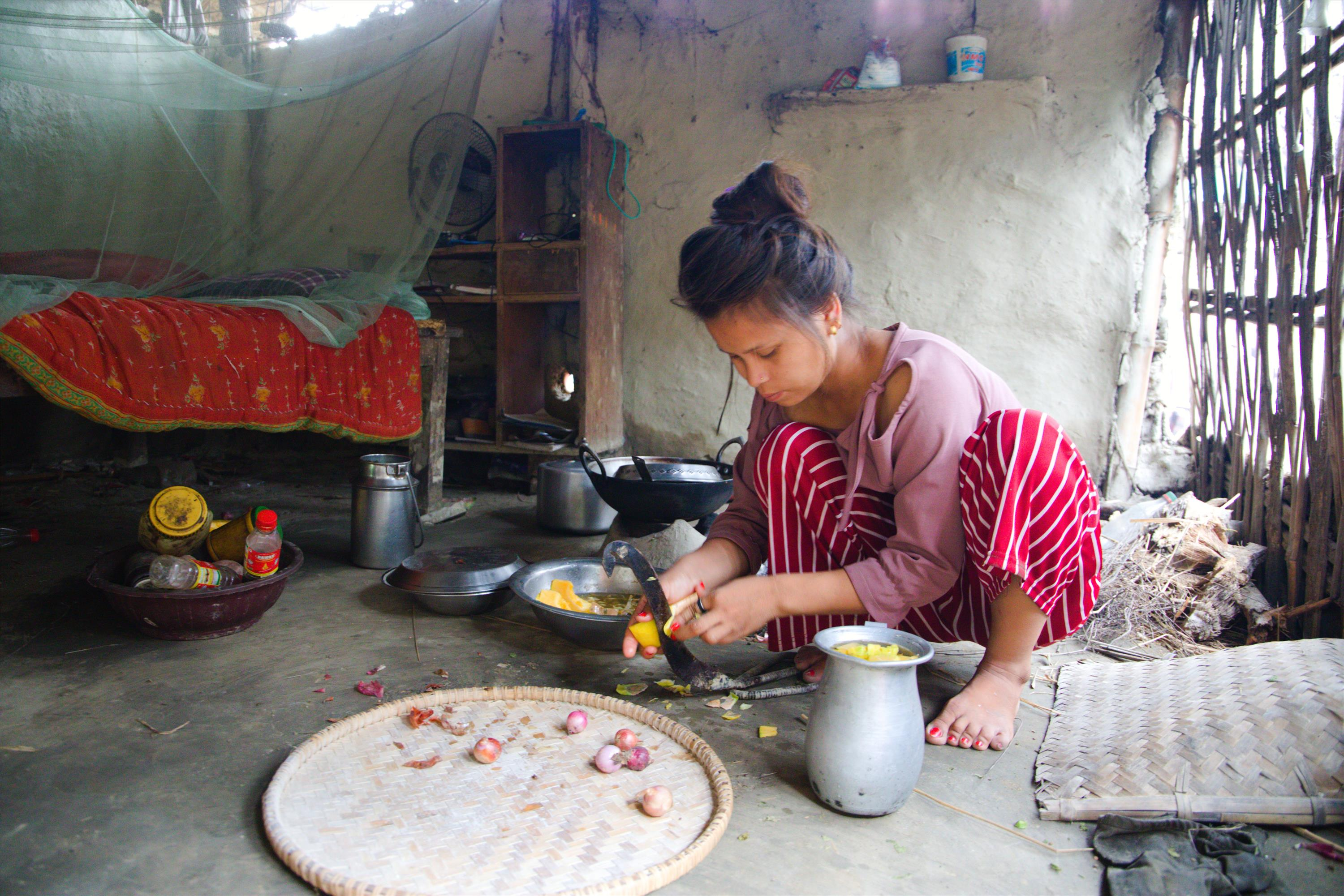 Prabha prepares food for her family