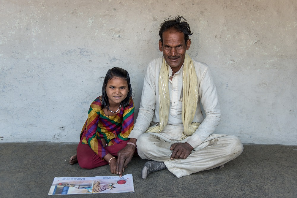 Sakhi and her father read together