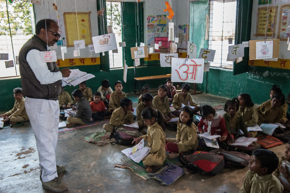 Bal teaches students in his classroom using Literacy Boost methods