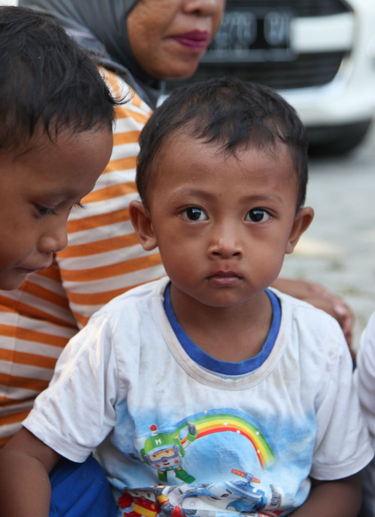 "alt=""Small boy impacted by the earthquake and tsunami in Palu, Indonesia"""
