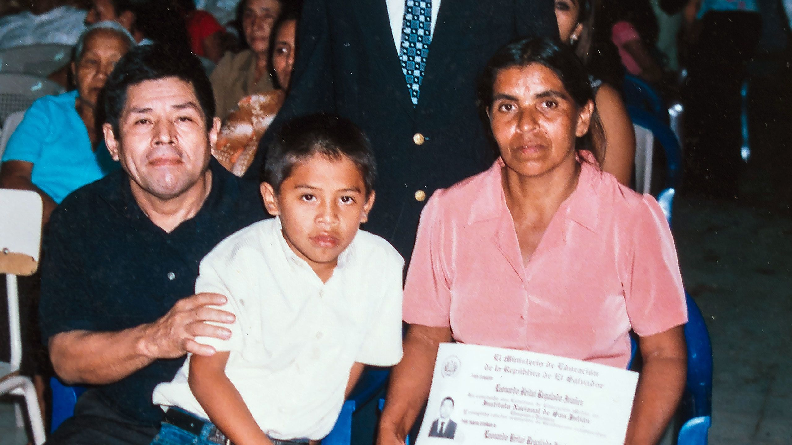 "alt=""Leonardo, with his parents at his graduation"">"