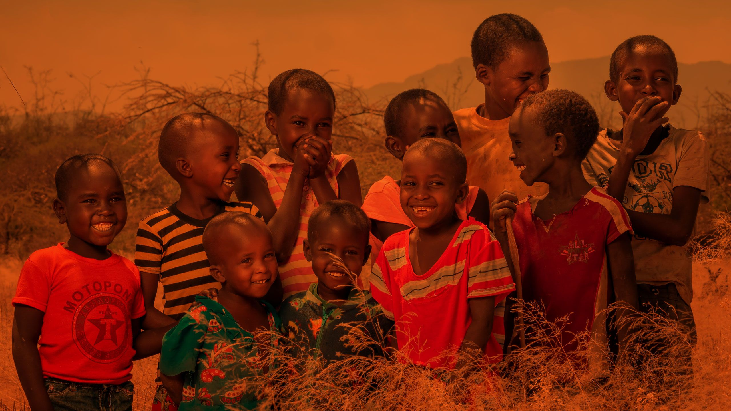 """<Alt=""""Together we've impacted the lives of over 200 million vulnerable children by tackling the root causes of poverty."""">"""