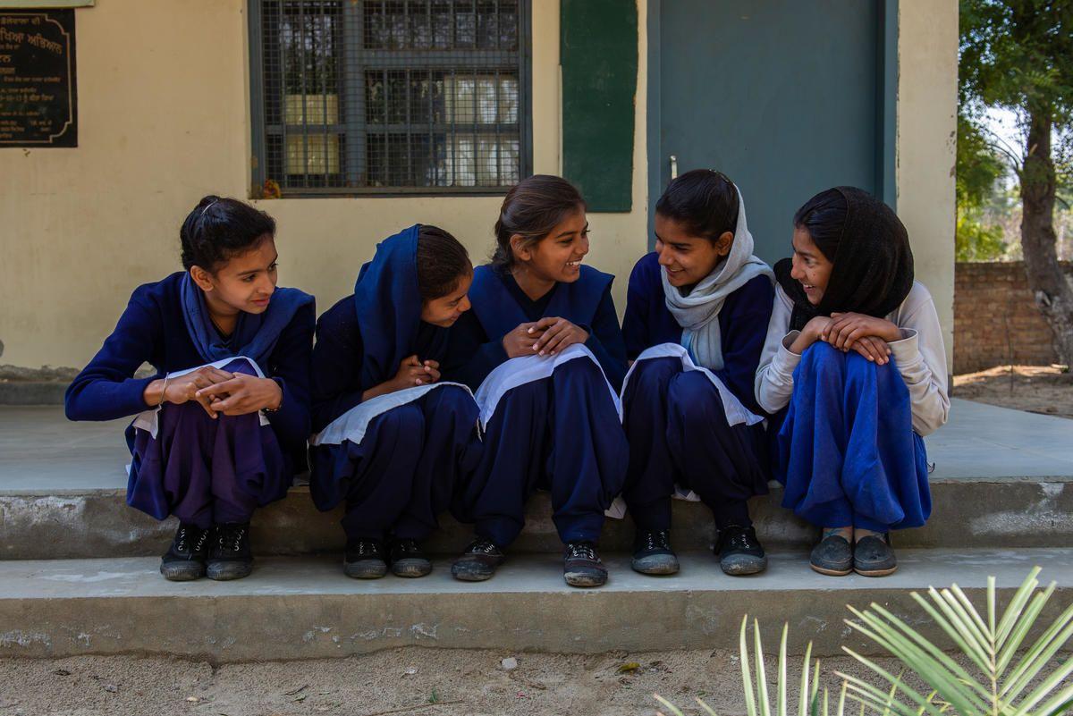Girls sitting together on a school step