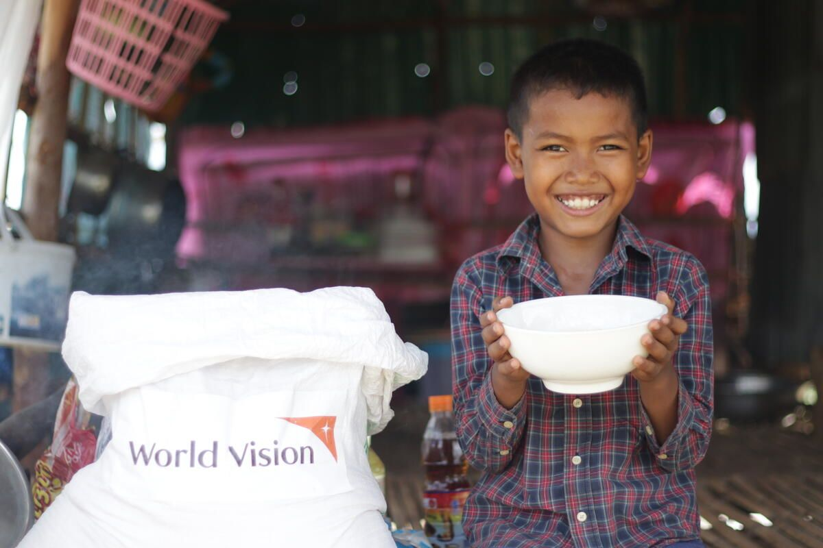 """""""I will eat two plates of rice!"""" says Doeurn after his family received an emergency food kit to help them weather the COVID-19 pandemic."""