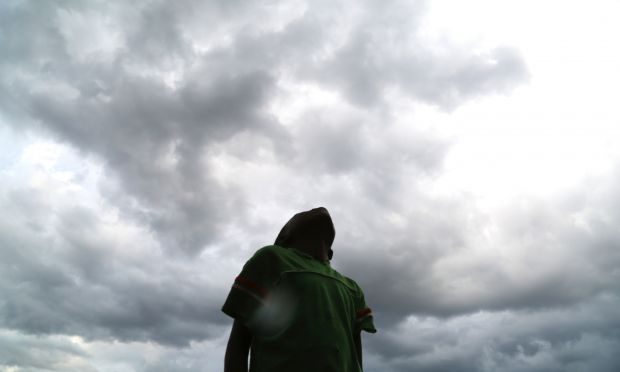 d03a75accaf9 13 year old Precious Lameck looks at the sky with heavy clouds but strong  winds blowing them clouds away in minutes and they are yet to receive real  rains.
