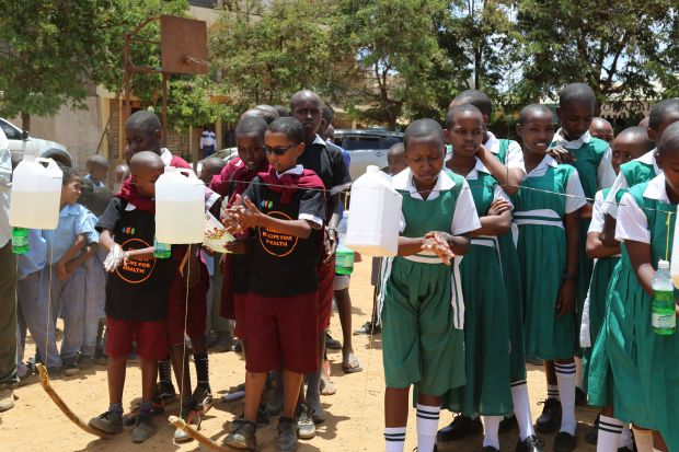 School children in Kitui County washing their hands with soap and water from tippy taps during the 2018 Global Handwashing Day celebrations in Kenya. ©2018 World Vision/ Photo by Susan Otieno