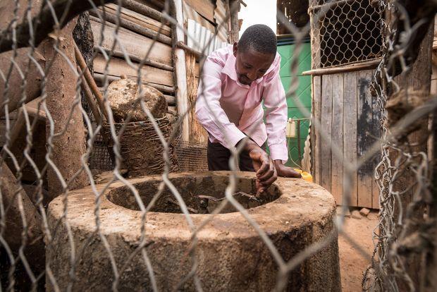 Phocas works at his farm in Rwanda