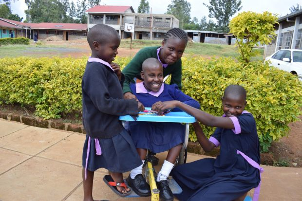 As a result of the wheelchair she received from World Vision, Isabella,13, from Western Kenya is now able to play with friends and enjoy life. ©2018 World Vision/Photo by Sarah Ooko.